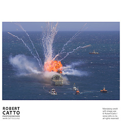 Explosions rock the former frigate HMNZS Wellington (aka F69) as it is sunk off the south coast of Wellington, New Zealand.  The wreck will lie in 26m of water, and is expected to be an attraction for divers.