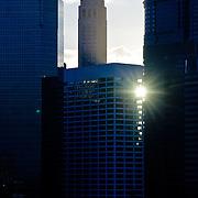 Sun setting through the buildings of Manhattan