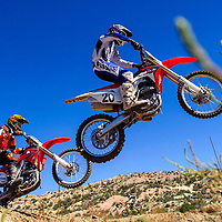 100414       Cable Hoover<br /> <br /> Colbert Clark and Justin Humphries compete for first place in the open beginner class of the Scott Costley Memorial Motocross race Saturday at the Gallup OHV MX Park.