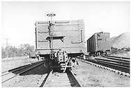 """""""B"""" end view of D&RGW high-side gondola #1108 at Salida.  A standard gauge boxcar is in the background.<br /> D&RGW  Salida, CO  Taken by Maxwell, John W. - 9/25/1949"""