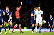 Referee Tobias Welz shows Dor Peretz (11) (Maccabi Tel Aviv)of Israel the yellow card during the UEFA Nations League match between Scotland and Israel at Hampden Park, Glasgow, United Kingdom on 20 November 2018.