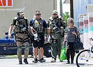Robin Zielinski – Sun-NewsDASO Special Response Team members escort an unidentified woman of an officer-involved crime scene on Wednesday after she appeared to have accidently wondered into the area.