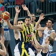 Efes Pilsen's Kerem GONLUM (R) and Fenerbahce's Roko Leni UKIC (C) during their Turkish Basketball Legague Play-Off semi final second match Efes Pilsen between Fenerbahce at the Sinan Erdem Arena in Istanbul Turkey on Friday 27 May 2011. Photo by TURKPIX