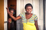 Reconocidos: Nacidos extranjeros. Micaela José Josefa tiene que pagar el equivalente a 10 dólares en pasaje, una décima parte su sueldo, cada vez que visita la delegación local de la Junta Central Electoral donde está intentando regularizar a su hija desde hace dos años sin éxito. Los padres de Micaela nacieron en Republica Dominicana, igual que ella y su esposo, y todos tienen documento de identidad, pero sus abuelos nacieron en Haiti y esa es la causa por la cual la JCE no le expide ahora el documento para su hija. Editorial and Commercial Photographer based in Valencia, Spain |Portraits, Hospitality, News, Sports, Media Coverage for Events