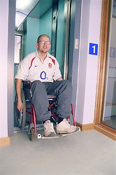 Young man; who is a wheelchair user; using lift at day centre for homeless and vulnerably housed young people,