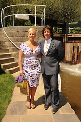 Th 2010 Royal Horticultural Society Chelsea Flower show in the grounds of Royal Hospital Chelsea, London on 24th May 2010.<br /> <br /> Picture shows:-LAURENCE & JACKIE LLEWELYN-BOWEN