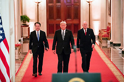 October 8, 2018 - Washington, DC, United States of America - U.S President Donald Trump, center, walks with retired Supreme Court Justice Anthony Kennedy, right, and Judge Brett Kavanaugh, prior to a symbolic public swearing-in at the White House October 8, 2018 Washington, DC. (Credit Image: © Joyce N. Boghosian via ZUMA Wire)