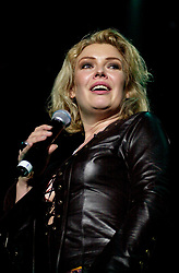 Kim Wilde steps out of the her TV Gardening clothes and Back on Stage to Tour with<br /><br />Steve Starnge (Visage)<br />Claire Grogan (Altered Images)<br />The Belle Stars<br />Dollar<br />Kim Wilde<br />The Human League<br />Play on the Here and Now  Christmas Party Tour at Sheffields Hallam FM Arena Friday 13th December 2002<br /><br />[#Beginning of Shooting Data Section]<br />Nikon D1 <br />2002/12/13 22:49:02.5<br />JPEG (8-bit) Fine<br />Image Size:  2000 x 1312<br />Color<br />Lens: 80-200mm f/2.8-2.8<br />Focal Length: 80mm<br />Exposure Mode: Manual<br />Metering Mode: Spot<br />1/200 sec - f/2.8<br />Exposure Comp.: 0 EV<br />Sensitivity: ISO 800<br />White Balance: Auto<br />AF Mode: AF-S<br />Tone Comp: Normal<br />Flash Sync Mode: Not Attached<br />Color Mode: <br />Hue Adjustment: <br />Sharpening: Normal<br />Noise Reduction: <br />Image Comment: <br />[#End of Shooting Data Section]