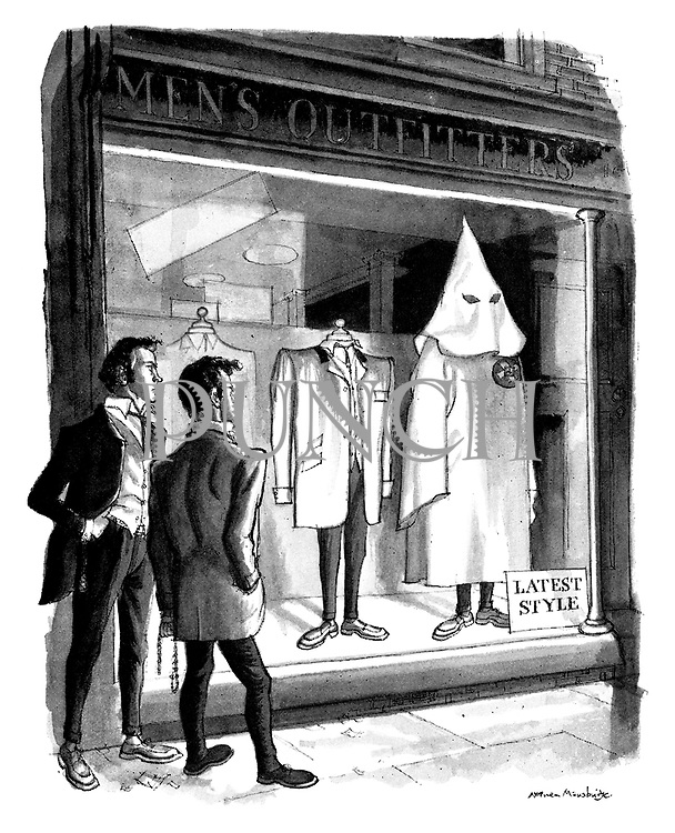 (Two youths see a Klu Klux Klan outfit displayed as the lates style in the window of an Men's Outfitters)