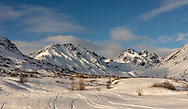 Late afternoon light on Talkeetna Mountains and Archangel Valley at Hatcher Pass in Southcentral Alaska. Winter.
