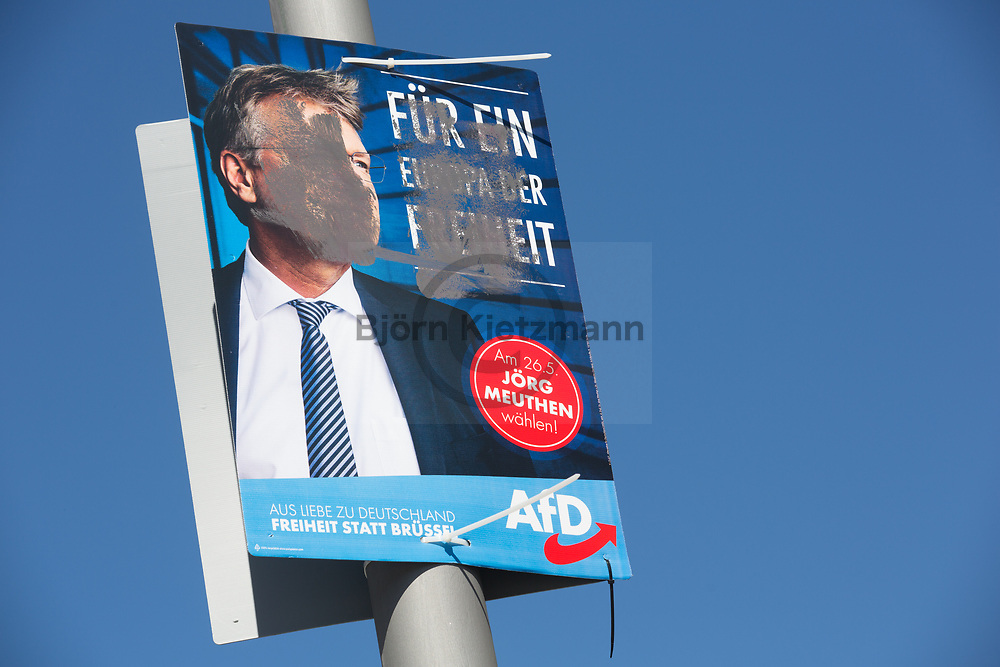 Berlin, Germany - 22.04.2019 <br /> <br /> Damaged election poster of the far right Alternative for Germany to the European Election 2019 in Berlin-Mitte.<br /> <br /> Beschaedigte AfD-Wahlplakate zur Europawahl 2019 in Berlin-Mitte.<br /> <br /> Photo: Bjoern Kietzmann