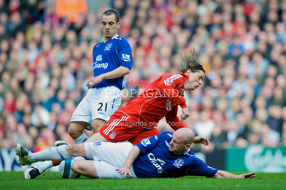 LIVERPOOL, ENGLAND - Sunday, March 30, 2008: Liverpool's Fernando Torres is scythed down by Everton's Lee Carsley during the 207th Merseyside derby, in the Premiership match at Anfield. (Photo by David Rawcliffe/Propaganda)