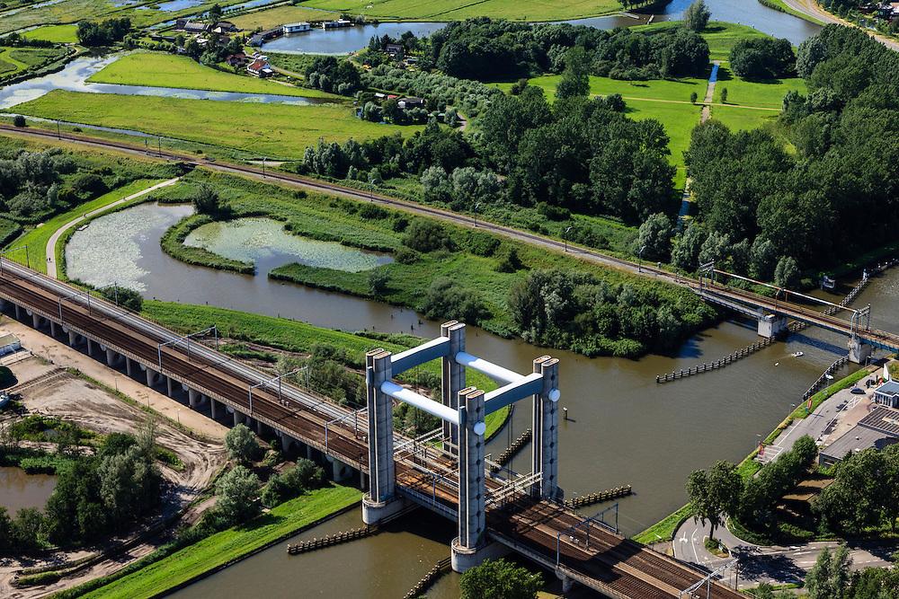 Nederland, Zuid-Holland, Gouda, 15-07-2012; spoorbrug over de Gouwe (viersporige hefbrug). Hoge Gouwebrug..Railway and lift bridge over the river Gouwe. luchtfoto (toeslag), aerial photo (additional fee required).foto/photo Siebe Swart