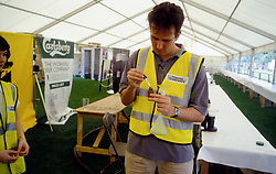 Trading Standards Officer using defoaming agent to measure Guinness delivery to pumps at Fleadh; London UK