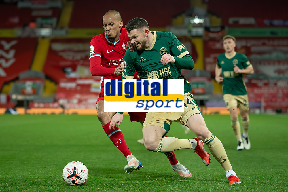 Football - 2020 / 2021 Premier League - Liverpool vs Sheffield United - Anfield<br /> <br /> Sheffield United's Oliver Burke battles with Liverpool's Fabinho<br /> <br /> COLORSPORT/TERRY DONNELLY