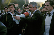 Moscow, Russia, 03/10/1993..Rebel leader Vice President Alexander Rutskoi,  surrounded by bodyguards, instructs supporters to storm the central television station. When President Boris Yeltsin dissolved the opposition-dominated Russian Parliament,  deputies and supporters, led by Vice President Alexander Rutskoi, barricaded themselves inside the White House. After a 10 day stand-off the situation exploded into violence between pro and anti Yeltsin forces.