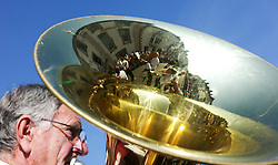 "© Licensed to London News Pictures. 13/07/2013<br /> <br /> Durham City, England, United Kingdom<br /> <br /> A man plays with his colliery band during the Durham Miners Gala.<br /> <br /> The Durham Miners' Gala is a large annual gathering held each year in the city of Durham. It is associated with the coal mining heritage of the Durham Coalfield, which stretched throughout the traditional County of Durham, and also gives voice to miners' trade unionism. <br /> <br /> Locally called ""The Big Meeting"" or ""Durham Big Meeting"" it consists of banners, each typically accompanied by a brass band, which are marched to the old Racecourse, where political speeches are delivered. In the afternoon a Miners' service is held in Durham Cathedral <br /> <br /> Photo credit : Ian Forsyth/LNP"