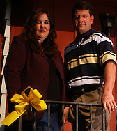 07/13/05 Omaha, Neb.Kelly  and Jim Jolkowski, standing in front of a yellow ribbon on their porch, they are parents sesarching  for their missing son Jason Jolkowski. .Also founder of http://www.projectjason.org/.. (photo by Chris Machian/Prairie Pixel Group).