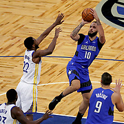 ORLANDO, FL - FEBRUARY 19:  Evan Fournier #10 of the Orlando Magic attempts a shot over Andrew Wiggins #22 of the Golden State Warriors during the first half at Amway Center on February 19, 2021 in Orlando, Florida. NOTE TO USER: User expressly acknowledges and agrees that, by downloading and or using this photograph, User is consenting to the terms and conditions of the Getty Images License Agreement. (Photo by Alex Menendez/Getty Images)*** Local Caption ***  Evan Fournier; Andrew Wiggins
