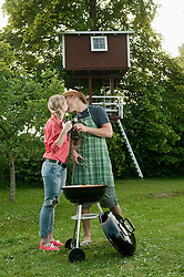 Young couple barbecue grill garden beer kissing