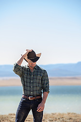 cowboy outdoors by a lake