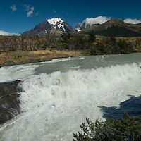 The Paine River pours over Paine Falls under Mount Almirante Nieto and the Towers of Paine in Torres del Paine National Park, Chile