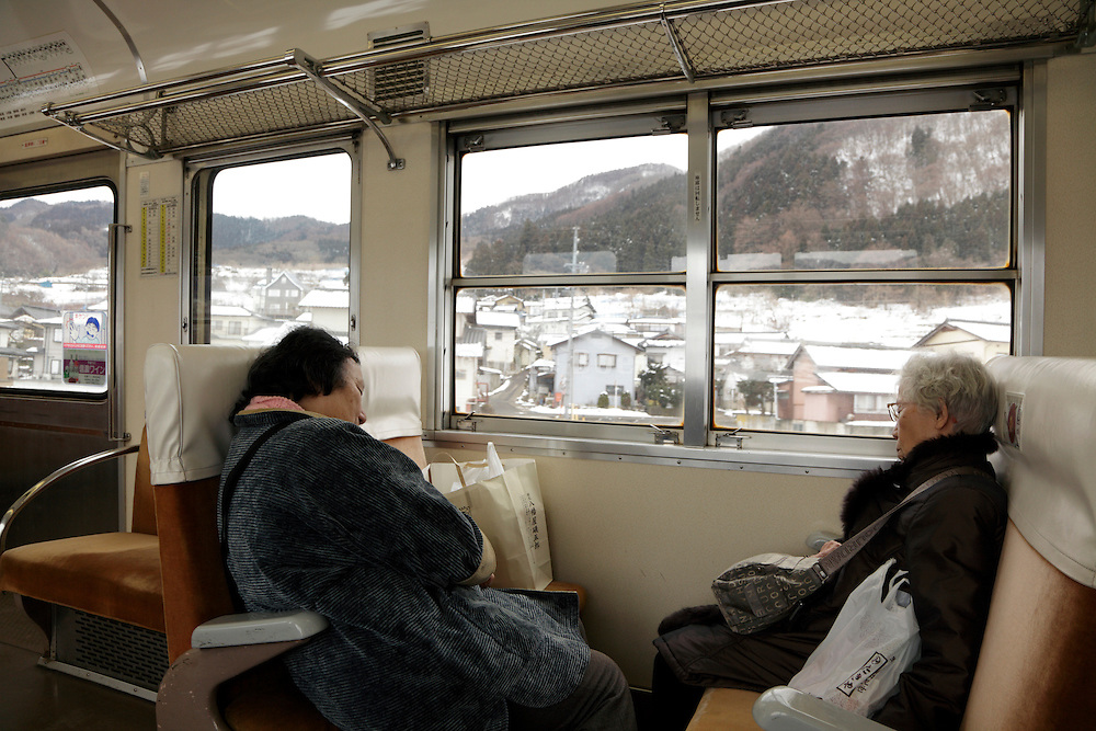 two female persons sleeping in the train