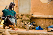 A man sleeps on a chair in Tano Akakro, Cote d'Ivoire on Saturday June 20, 2009.