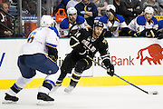 Dallas Stars left wing Eric Nystrom (24) attacks the net against St. Louis Blues defenseman Wade Redden (6) at the American Airlines Center in Dallas, Texas, on January 26, 2013.  (Stan Olszewski/The Dallas Morning News)