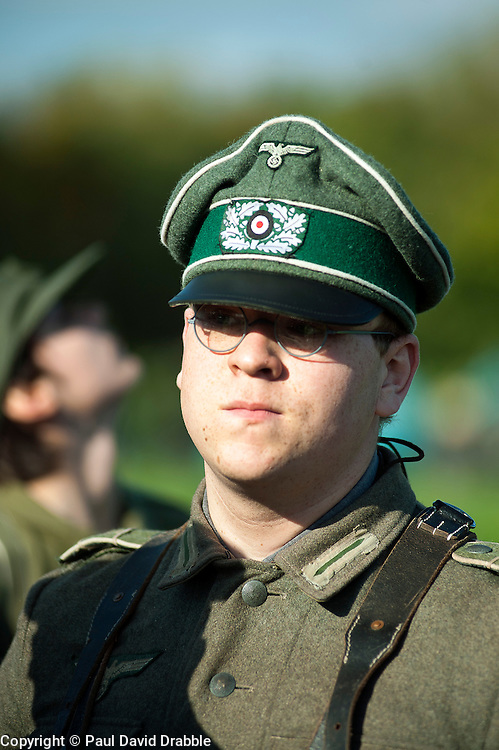 German Panzer Grenadier in Crusher style peaked cap and leather Y straps on the living history camp at the Pickering showground during the Annual Wartime Weekend 2011.Saturday 15th October 2011. Image © Paul David Drabble