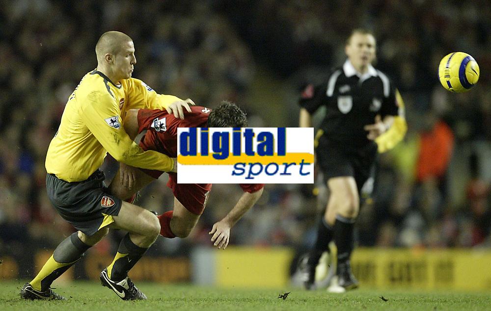 Photo: Aidan Ellis.<br /> Liverpool v Arsenal. The Barclays Premiership. 14/02/2006.<br /> Arsenal's Phillipe Senderos brings down Liverpool's Robbie Fowler
