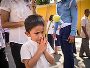 02 FEBRUARY 2013 - PHNOM PENH, CAMBODIA:  A boy waits in line to see the crematorium of King Norodom Sihanouk during the mourning period for Sihanouk, who ruled Cambodia from independence in 1953 until he was overthrown by a military coup in 1970. Sihanouk died in Beijing, China, in October 2012.     PHOTO BY JACK KURTZ