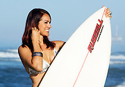 Woman Smiling In Bikini Holding Surf Board