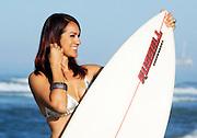 Woman Smiling In Bikini Holding Surf Board