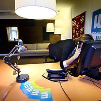 Nederland, Amsterdam , 24 december 2013.<br /> Telefoniste van telefonische hulplijn Sensoor in gesprek met een client.<br /> In de toekomst verander de naam Sensoor in HA.<br /> (Telefoniste moest onherkenbaar in beeld gebracht worden)<br /> <br /> Foto:Jean-Pierre Jans