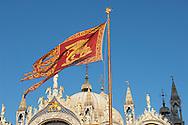 Venician flag flying over Saint Marks Basilica - Venice