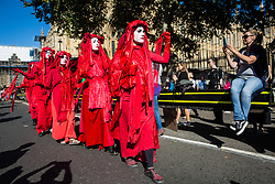 London, UK. 20 September, 2019. The Red Brigade of Extinction Rebellion join thousands of students and climate campaigners taking part in the second Global Climate Strike in protest against a lack of urgent action by the UK Government to combat the global climate crisis. The Global Climate Strike grew out of the Fridays for Future movement and is organised in the UK by the UK Student Climate Network.