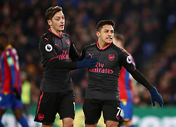 Arsenal's Alexis Sanchez (right) celebrates scoring his side's first goal of the game during the Premier League match at Selhurst Park, London.