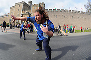 an official rugby world cup helper show's fans which way to go outside Cardiff castle.  Rugby World Cup 2015 pool A match, Australia v Fiji at the Millennium Stadium in Cardiff, South Wales  on Wednesday 23rd September 2015.<br /> pic by  Andrew Orchard, Andrew Orchard sports photography.