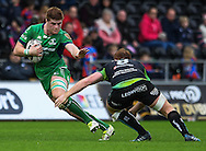 Connacht's Sean O'Brien is tackled by Ospreys' Dan Baker.<br /> <br /> Guinness Pro12 rugby match, Ospreys v Connacht rugby at the Liberty Stadium in Swansea, South Wales on Saturday 7th January 2017.<br /> pic by Craig Thomas, Andrew Orchard sports photography.
