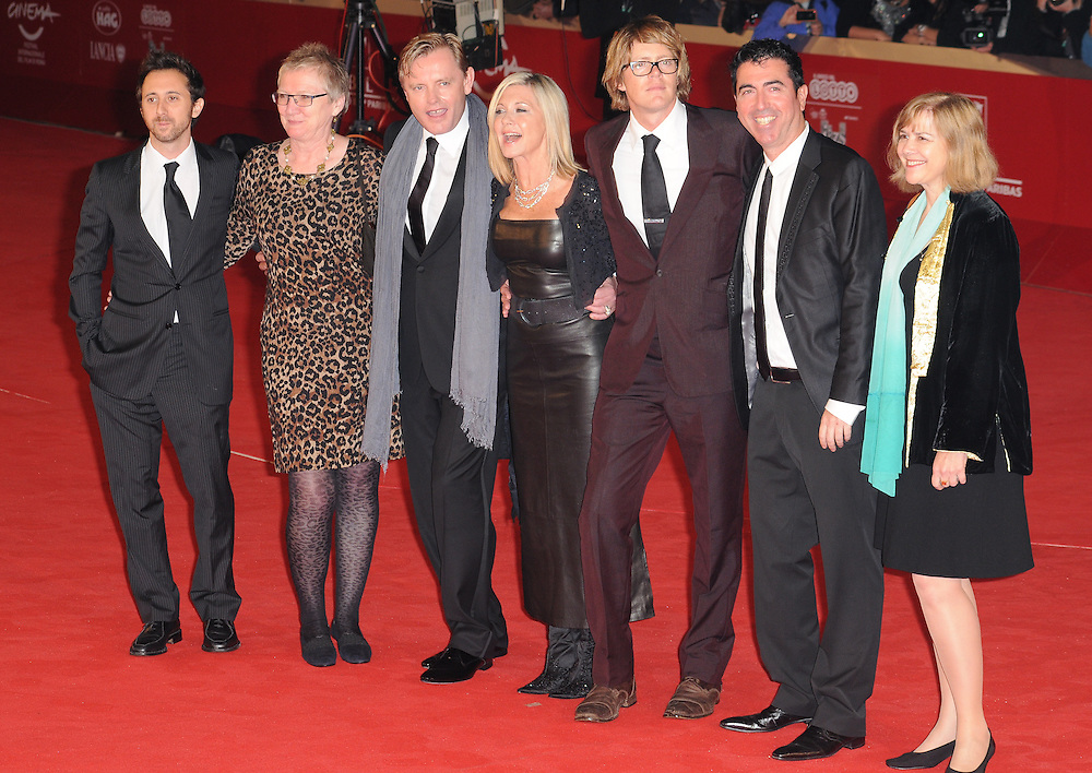"""Olivia Newton John, Stephan Elliott, Kris Marshall at the premiere of """"A Few Best Men"""" during the 6th International Rome Film Festival..{month name}28, 2011, Rome, Italy.Picture: Catchlight Media / Featureflash"""