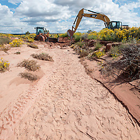 091813        Brian Leddy<br /> Workers dig in Oak Wash Wednesday in Zuni. The was saw heavy flash flooding that eventually made its way to the village in Zuni.