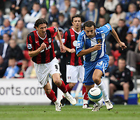 Photo: Sportsbeat Images.<br />Wigan Athletic v Fulham. The FA Barclays Premiership. 15/09/2007.<br />Wigan's Josip Skoko (R) takes the ball away from Fulham's Alexy Smertin