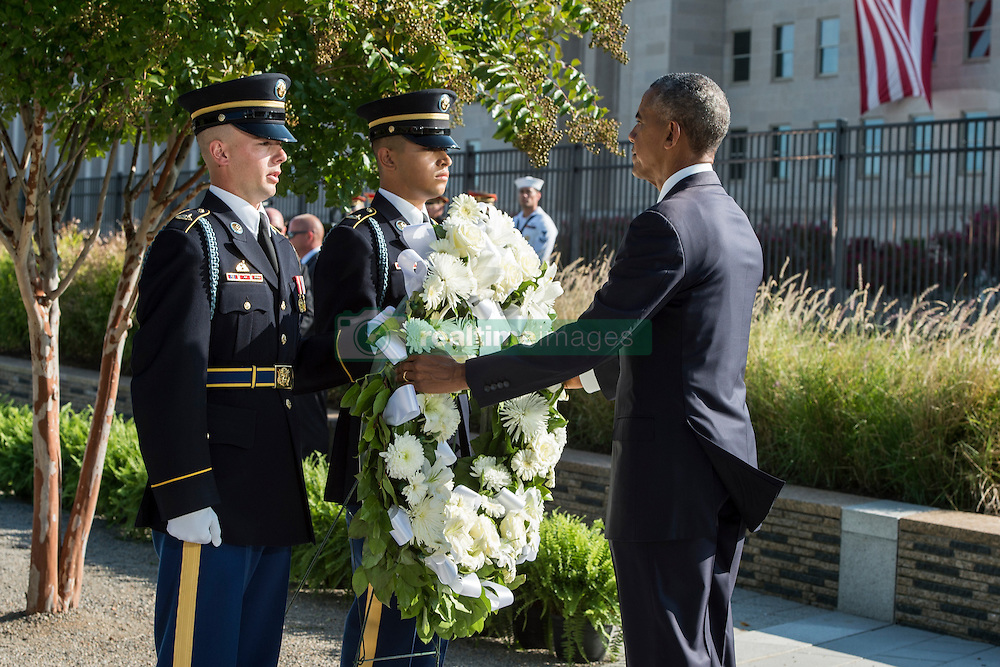 September 11, 2016 - Arlington, VA, United States of America - U.S President Barack Obama places a wreath at the Pentagon Memorial during a remembrance ceremony commemorating the 15th anniversary of the 9/11 terrorist attacks at the Pentagon September 11, 2016 in Arlington, Virginia. (Credit Image: © Tsgt. Brigitte N. Brantley/Planet Pix via ZUMA Wire)