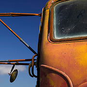 Rusted Autocar truck sits in the sun at Blue Heron Cheese, Tillamook, Oregon