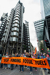 """© Licensed to London News Pictures. 03/09/2021. LONDON, UK.  Climate activists from Extinction Rebellion protest outside the Lloyds Building in the City of London to highlight the complicity of the financial industry on climate change.  The event takes place on day twelve of the two week 'Impossible Rebellion' protest to """"target the root cause of the climate and ecological crisis"""".  Photo credit: Stephen Chung/LNP"""