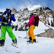 Tanner Flanagan points to some ski zones in the rocks of the Tetons with Kim Havell (R).