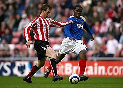 Sunderland's Stephen Caldwell and Portsmouth's Collins Mbesuma