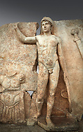 Close up of a Roman Sebasteion relief  sculpture of Ares, Aphrodisias Museum, Aphrodisias, Turkey. <br /> <br /> The nude and classically7 styled young god wears only a helmet and holds a spear (missing) in one hand and a shield in the other. At the left stands cuirass, and at the upper right corner hangs his sword. Ares was a god of war and was not later defaced by Christians probably because he so closely resembles a young emperor. .<br /> <br /> If you prefer to buy from our ALAMY STOCK LIBRARY page at https://www.alamy.com/portfolio/paul-williams-funkystock/greco-roman-sculptures.html . Type -    Aphrodisias     - into LOWER SEARCH WITHIN GALLERY box - Refine search by adding a subject, place, background colour, museum etc.<br /> <br /> Visit our ROMAN WORLD PHOTO COLLECTIONS for more photos to download or buy as wall art prints https://funkystock.photoshelter.com/gallery-collection/The-Romans-Art-Artefacts-Antiquities-Historic-Sites-Pictures-Images/C0000r2uLJJo9_s0