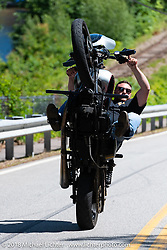One WheelJoe Decubellis pulling a wheelie as he rides Scenic Road during Laconia Motorcycle Week. NH, USA. Friday, June 15, 2018. Photography ©2018 Michael Lichter.